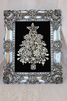 Framed vintage rhinestone brooch tree. Love love love this!