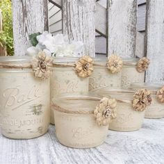 country chic decor - painted mason jars, twine and flowers. simple, beautiful