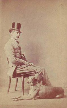 Dapper gentleman with dog.