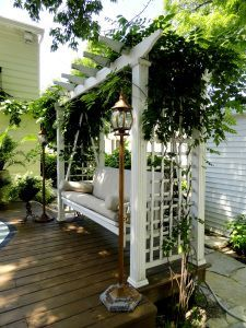 make bench off kitchen deck over air conditioner. deck swing attached to a pergola.