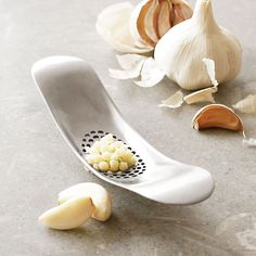 Joseph Joseph® Garlic Rocker™ | Sur La Table. I need this!! Presses are so annoying to clean.