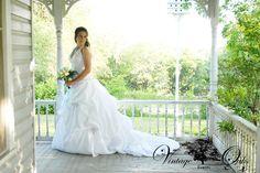 Vintage formal wedding. Bride portrait on wrap around porch. Vintage Oaks Events www.vintageoaksevents.com