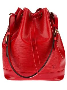 Red leather 'Noé' bucket bag from Louis Vuitton featuring a suede lining, drawstring fastening and adjustable shoulder strap.