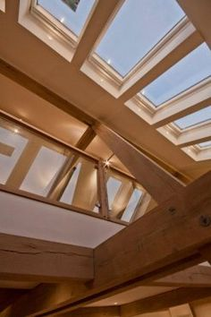 Looking up to glass and oak gallery by Roderick James Architects.