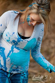 Gender reveal photo shoot. Start out in white with paint covered then throw it on each other. LOVE it!
