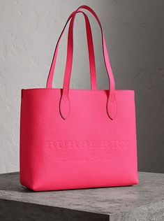 c3e57b566777 A versatile tote by  Burberry in Italian-tanned calf leather in a vibrant  neon