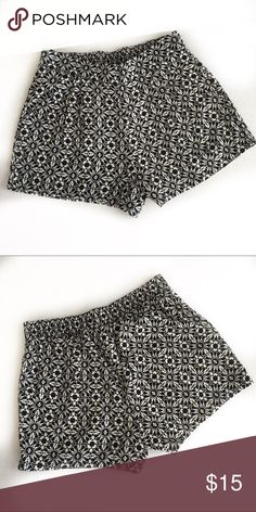 """One clothing geometric print skhorts One clothing shorts with black and white geometric design. Has pockets, elastic waist in the back laying flat waist about 14"""", inseam 3"""", length 13"""" one clothing Shorts"""