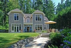 Traditional Landscape/Yard with Stacked stone retaining wall, Raised beds, French doors, Fence, Transom window, Pathway