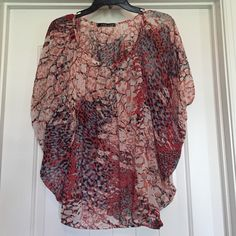 J.e.w.e.l.s multicolored sheer top size small J.e.w.e.l.s multicolored sheer top size small. Absolutely love this top!! Goes with almost any color cami and looks fantastic with black or white bottoms. J.e.w.e.l.s Tops