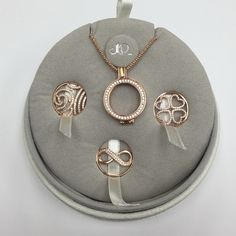 Open locket with three interchangeable charms. Rose gold open circle locket that can be worn without a charm inside or with the charms included in the set. Included three charms an infinity, waves of stones & four heart charm. Comes with a sterling silver rose gold plated chain also. 925 silver plated with rose gold. Mp design Jewelry Necklaces