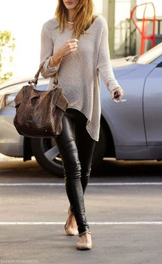Rosie Huntington-Whitely. Leather skinnies, taupe open knit draped sweater, brown leather bag, nude flats.