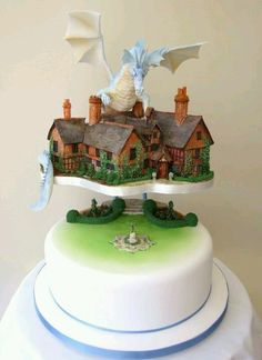 Amazing cake though wouldn't have the dragon love the houses