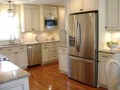 Beautiful painted cabinets that go to the ceiling ... with stainless steel appliances.