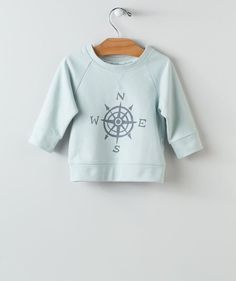 Point your baby boy toward a day full of adventure in our True North pullover. This is one of the newest print toddler tops in our North Star fall collection that features a thicker all-cotton fabric and three quarter sleeves that's perfect for the temperature fluctuations on any given day. The simple compass design was created by one of our Hallmark Baby artists and you can only get it right here online.