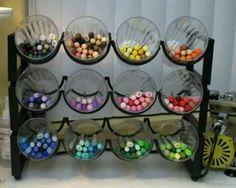 What to do with a wine rack.... cups to put markers or pencils in. Maybe Mason Jars?