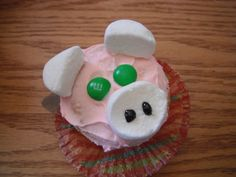 DIY pig cupcakes!! what you will need:2  marshmallow's, 2 m's, cake mix and pink icing