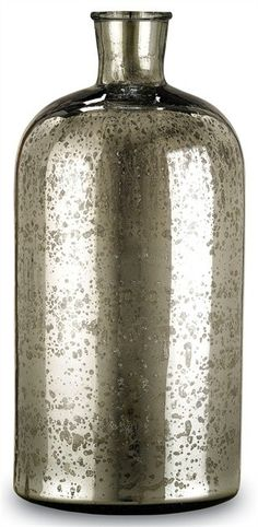 Currey Cypriot Bottle Medium in Antique Silver 1024 - Currey Cypriot Bottle, Medium in Antique Silver 1024Beautiful mercury glass accent bottle. The antique silver surface reflects a classic sense of age. The cylindrical, petite form is complemented seamlessly in conjunction with the small and/or large Cypriot Bottle(s).Sku: 1024Manufacturer: CurreyColor: Antique SilverMaterial: Mercury GlassWeight: 5Package: 10Shipping: P-O/SCategory: AccessoriesDimensions: 9D X 18H