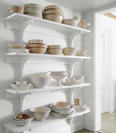 love this shelving to display my pottery collection. A Well Traveled Woman