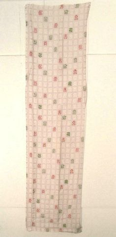 This is a fabric of a kimono from mid Showa period(Showa:1926-1989). It has unique kanji character 'kotobuki'(longevity) pattern, which is dyed