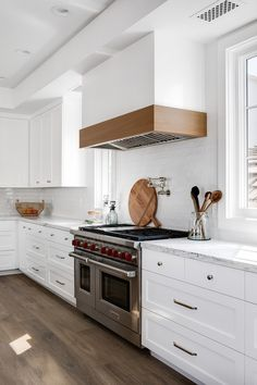 Kitchen mixed shaker and flat front cabinetry with Kitchen White Gloss Subway Tile backsplash and Rift Oak Kitchen Hood Trim Shaker Kitchen Cabinets, Farmhouse Sink Kitchen, Kitchen Tiles, New Kitchen, White Oak Kitchen, White Cabinets, Kitchen Dining, Kitchen Hood Design, Kitchen Hoods