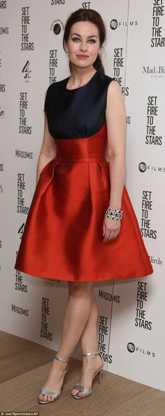 Polished perfection: ActressMaimie McCoy chose an elegant red and navy Sophia Kah AW'14frock