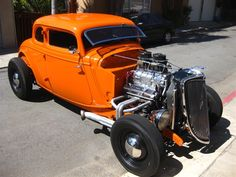 I love orange power. (1934 Ford Coupe hot rod)