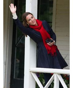 I love that Kate Middleton is a navy girl. The pairing of this lovely blue trench coat with bright red scarf are simply fabulous!