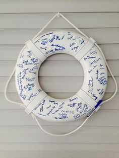 Have your guests sign a life ring rather than a guest book #diy #beach #decor