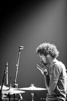 Hillsong United drummer praying right before a set