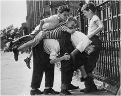 Henri Cartier Bresson Rough kids street game 'Monikity' usually a lot more players