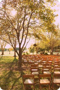 Farm   Destarte Wedding Barn   Lawndale NC   Vintage wooden chairs at an outdoor wedding on a farm