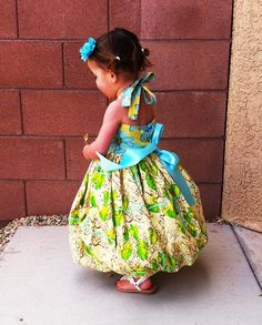This listing is for a PDF file, not a finished item. Dress this up with special occasion fabrics or choose your favorite quilters cotton. This dress is sure to turn heads and make your little one feel special. The back laces up like a corset and ties into a beautiful bow. The