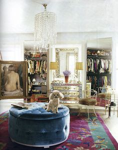 Bedroom used as closet. I want to live in here. Minus the poodle, plus my kitties of course.