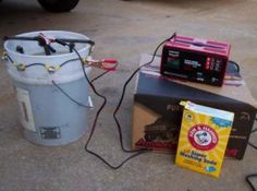 Electrolytic Rust Remover Homemade electrolytic rust remover constructed from a plastic bucket, rebar, and a battery