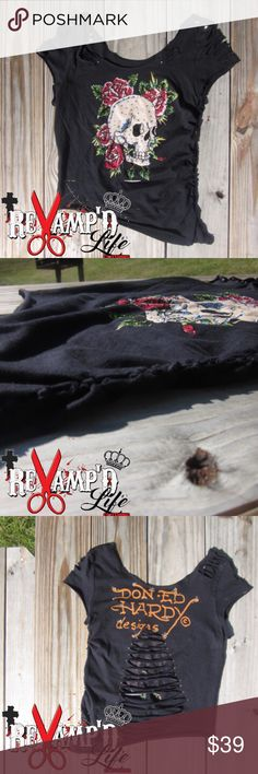 """Cut up bling embellished Ed Hardy skull shirt SM ••• 🛍 Ask for bundles to save $$ ••• always accepting offers! 🛍 •••  • This custom Ed Hardy shirt """"Iceyy"""" is cut into almost a croptop, tied down one side. Embellished with rhinestones and studs on both front and back. Is somewhat stretchy. Super unique & cute!  • size: small  #edhardy #christianaudigier #skulls #livefast #diepretty #rhinestones #embellished #studs #spikes #revamped #buckle #restyled #reworked #upcycledfashion #diy…"""