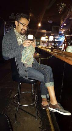 Man knitting in a bar (Christopher Salas)