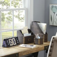 Whether you work from home, head to work everyday or just have an area at home for paying bills, keeping your desk organized is necessary!