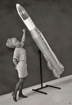 ... woman with model of Atlas ICBM | Flickr - Photo Sharing!