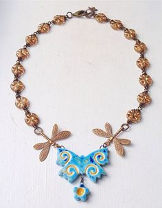 Blue gold yellow butterfly dragonfly necklace by ButtonedUpBeads