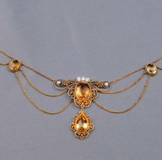 Antique 14kt Gold, Citrine, and Freshwater Pearl Festoon Necklace, set with a cushion-cut citrine, suspending a drop, faceted citrine and freshwater pearl accents, in a scrolling mount, with swags of trace link chain, lg. 16 in.  Victorian or Victorian style.