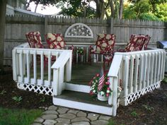 We found these metal deck chairs at a garage sale for a dollar each, My husband sandblasted them, I primed and painted them ...and we even bought the cushions on sale 1/2 price. (I do love a deal!) The fence decoration was another garage sale find...just needed a coat of white paint.