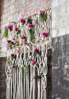 Bohemian macrame knotted backdrop with flowers / http://www.deerpearlflowers.com/boho-macrame-knotted-wedding-decor-ideas/