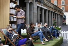 Temporary lawn in the city. Pop up library and outdoor reading room.