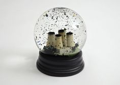 """No Globes""  Mixed media snow globe. The single greatest threat to the climate comes from burning coal but despite this a whole new fleet of dirty coal-fired power stations are on the verge of being built in the UK (the first for 30 years). The snow globe was designed for Ctrl.Alt.Shift in anticipation of the United Nations Climate Change Conference in Copenhagen 2009."