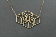 geometric jewelry, geometric necklace, cubes,cubic jewelry, square necklace square geometric necklace, a pendant with four cubes with a 3