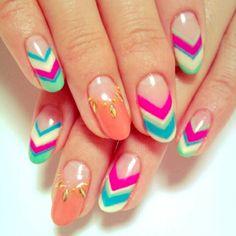 Arrow manicure design with blue, green, white, fuchsia and a little peach with a bit of gold to glam it up.