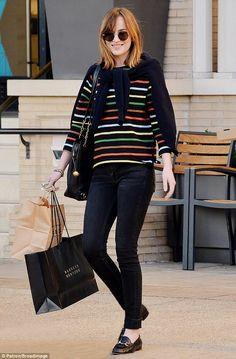 Dakota Johnson wears multi-coloured sweater in New York