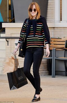 Getting her money's worth! Dakota Johnson wore her  favourite top again when she shopped in NYC on Friday