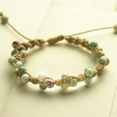 Rope bracelet with green glass beads