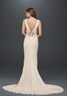 Oh the glamour! Love the vintage style of this @davidsbridal gown. Jeweled Crepe Sheath Wedding Dress with Low Back | David's Bridal Spring 2017 #davidsbridal #ad